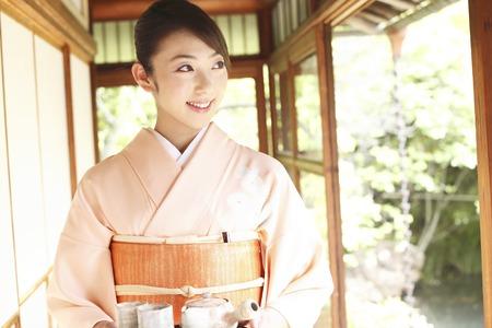 Kimono woman carrying a tea