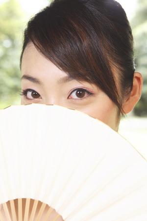 doings: Kimono woman with a fan Stock Photo