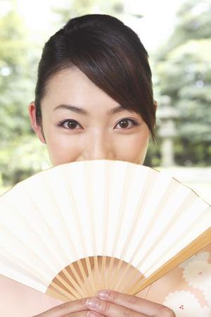Kimono woman with a fan Stock Photo