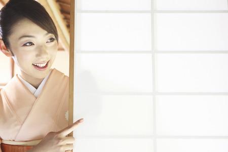 Kimono woman pointing to a shoji finger