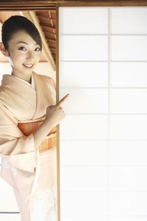 doings: Kimono woman pointing to a shoji finger