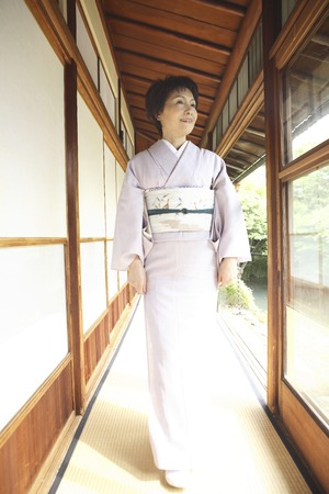doings: Kimono woman walking down the hallway Stock Photo