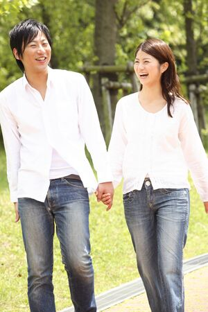 Couples Park to walk hand in hand photo