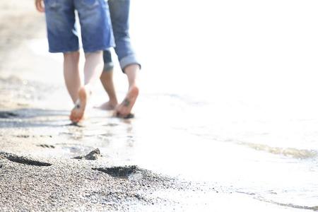 Couples walk a couple beach walk on the beach