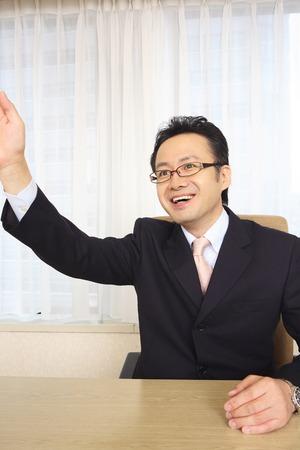 raise hand: Businessmen raise hand