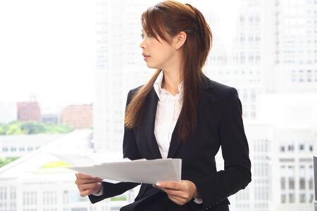 Office Lady with a material