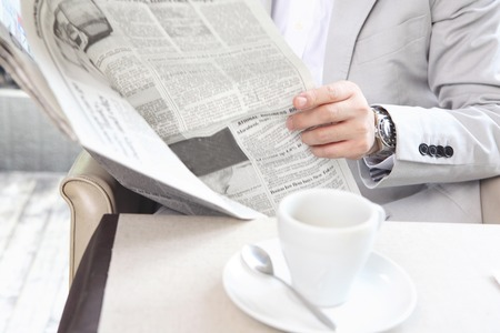read: Businessman image Read newspaper Stock Photo