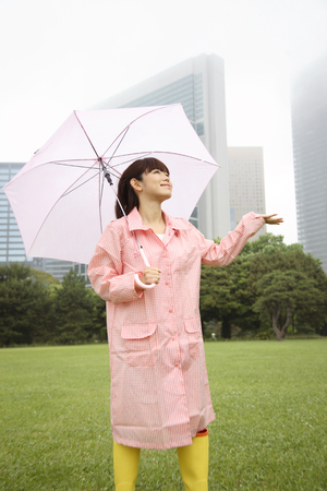 whether: Women to make sure whether it is raining