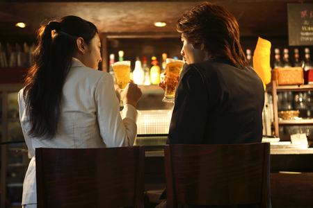 Rear View of couples drinking at the counter 스톡 콘텐츠