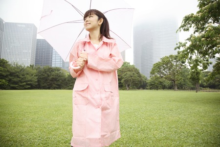 Woman walking in the park with an umbrella