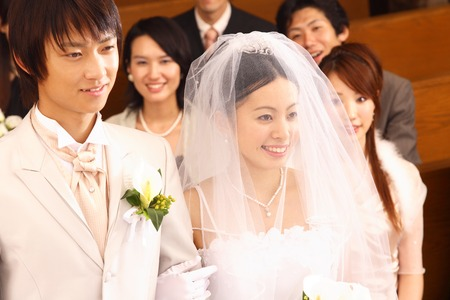 Bride and groom walking arm in arm 스톡 콘텐츠