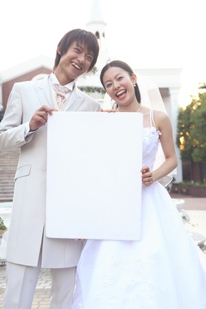 message board: Groom-bride with a message board Stock Photo