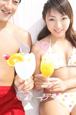 Couple drinking tropical drinks photo