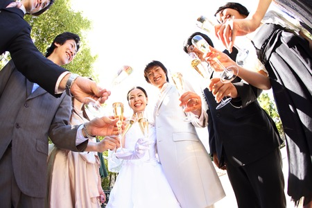 Bride and groom toasting with friends