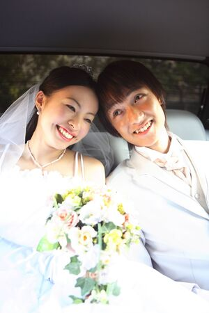 mutually: Groom, bride mutually attracted the face in the car