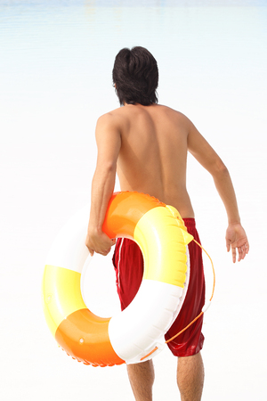 inner tube: Rear of the men who run the waterside with a inner tube