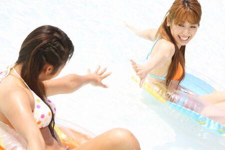 frolic: Two women frolic in the pool