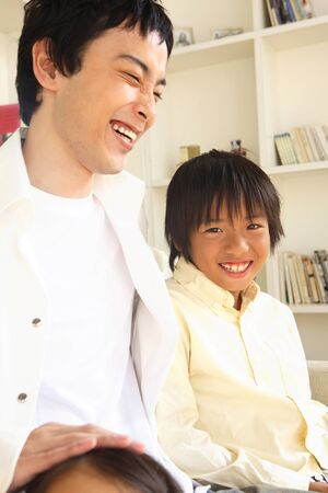 nuclear family: Father and son you are laughing
