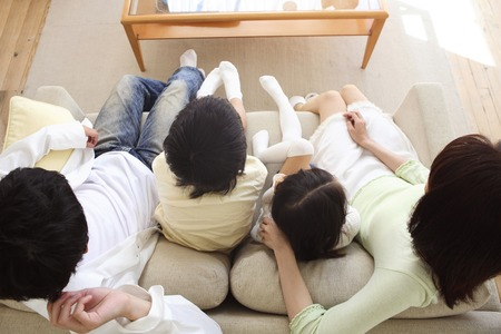 family  room: Family relaxing in the living room