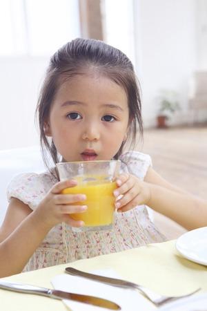 Girl drinking juice photo