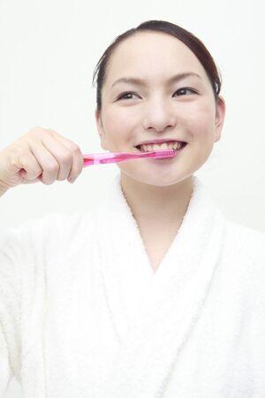 adult brushing teeth: Lady brushing Stock Photo