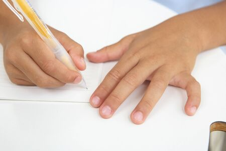 centralised: Hand you write a character in a notebook Stock Photo