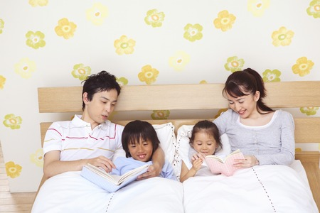 oriental girl: Parents put a child to sleep