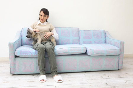 Portrait of women who have had a dog 写真素材