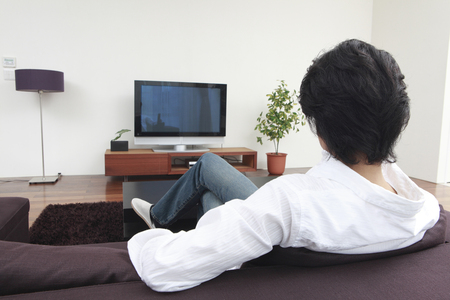 Rear of the men who watch TV in the living room