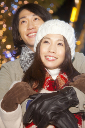 christmas illuminations: Couplesll look at the Christmas illuminations Stock Photo