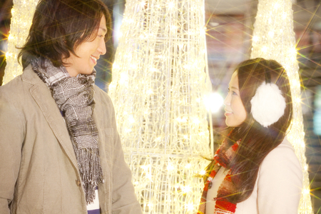 christmas illuminations: Couples each other staring in front of the Christmas illuminations