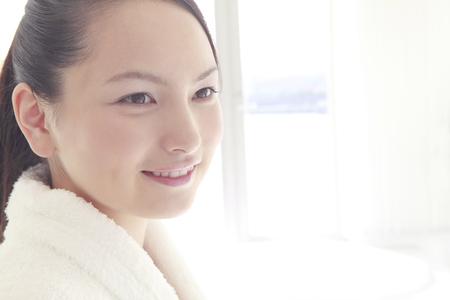 oriental bathrobe: Women laughing and wearing bathrobes