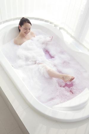 woman in bath: Woman relaxing in the bath of foam