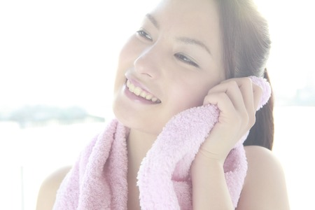 Female cheeks to wipe with a towel Stock Photo