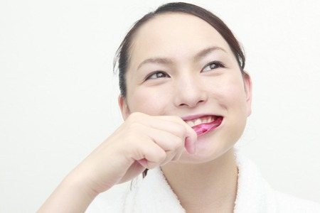 oriental bathrobe: Lady brushing Stock Photo