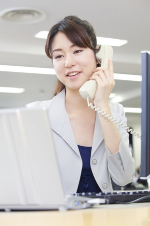 lady on phone: office lady on the phone Stock Photo