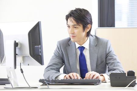 personal computer: Businessman to use the personal computer Stock Photo