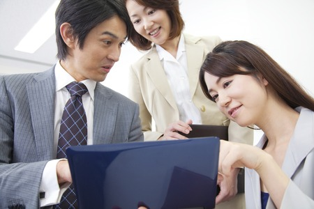 looking into: Businessman and OL looking into a laptop Stock Photo