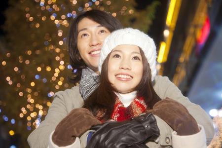 illuminations: Couplesll look at the Christmas illuminations Stock Photo