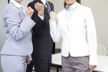 fist pump: Businessman and OL2 people to the guts pose