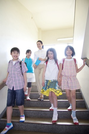 descend: Elementary school students descend the stairs