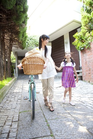 nuclear family: Mother and daughter go outside Stock Photo