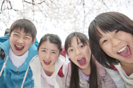 Four elementary school smile Stock Photo