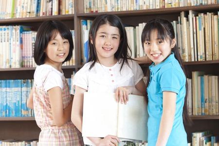 3 people smile in elementary school