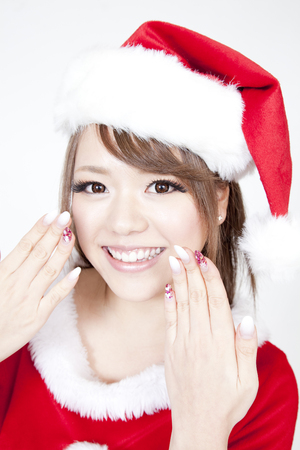 santa girl: Santa Girl to show the nail Stock Photo