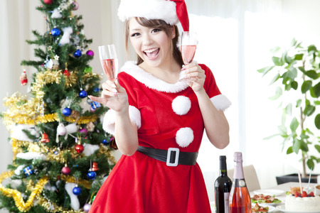 santa girl: Santa girl with champagne Stock Photo