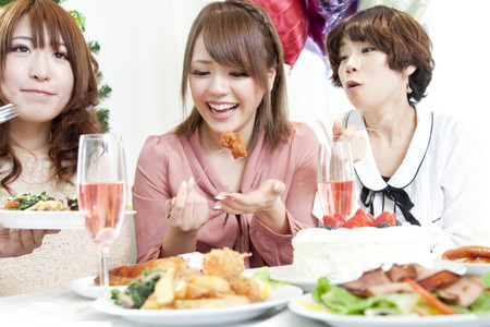 adorning: Women who eat the cuisine Stock Photo