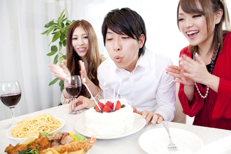 rollick: Men and women celebrating a birthday