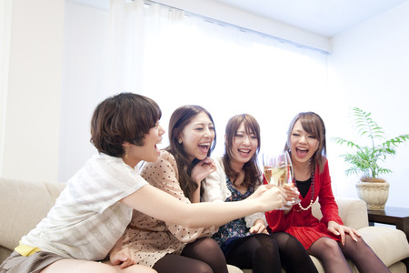resound: Women toasting with champagne