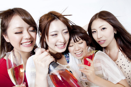 Women who dance with a champagne Stock Photo
